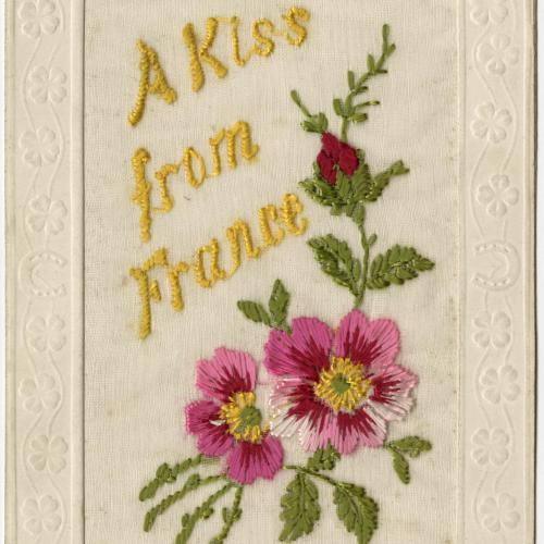 """Embroidered Post Card bearing the motto """"A Kiss from France"""" with floral motif"""