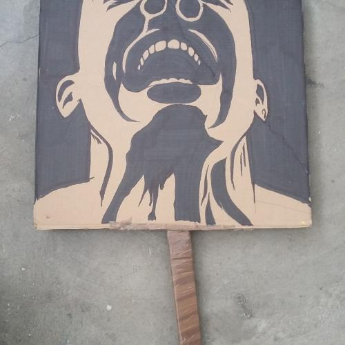 Placard with an image of a black man screaming