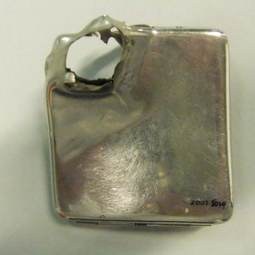 Nickel cigarette case with bullet hole