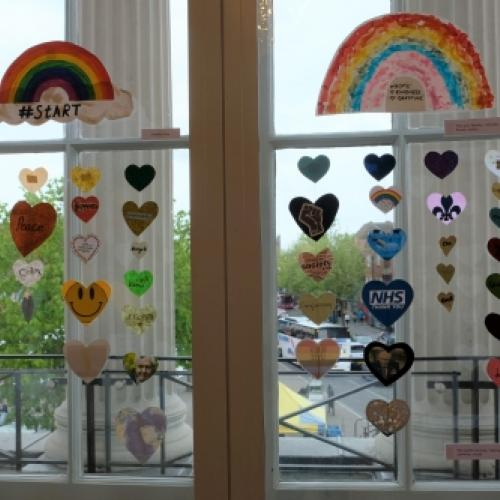 Hearts from the Rainbow Trail hanging in a window