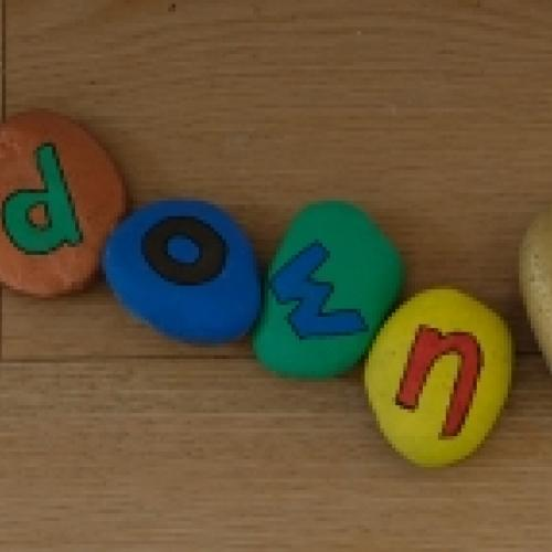 Lockdown Life spelled out in painted rocks