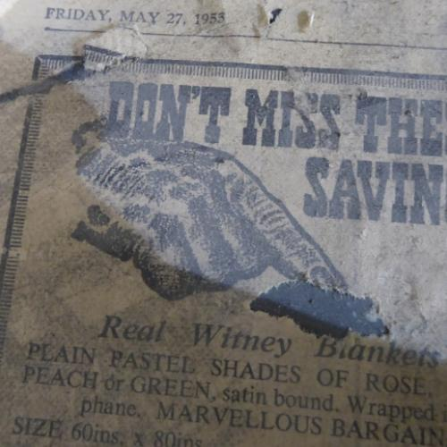 1955 newspaper found under the table cover in the Courtroom