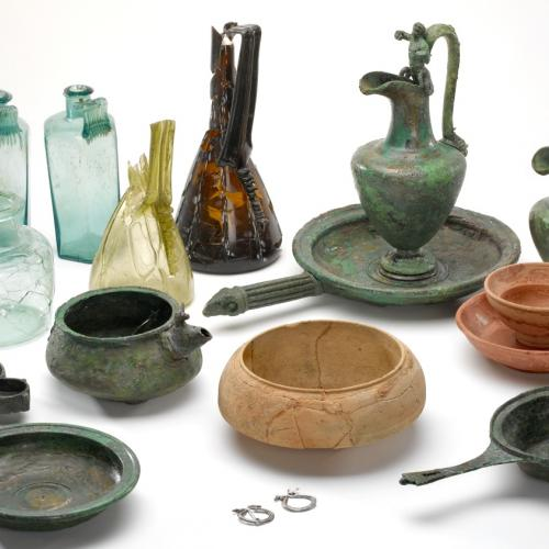 A Collection Of Glass, Pottery and Metal Items Found In A Burial Site Called Turners Hall Farm
