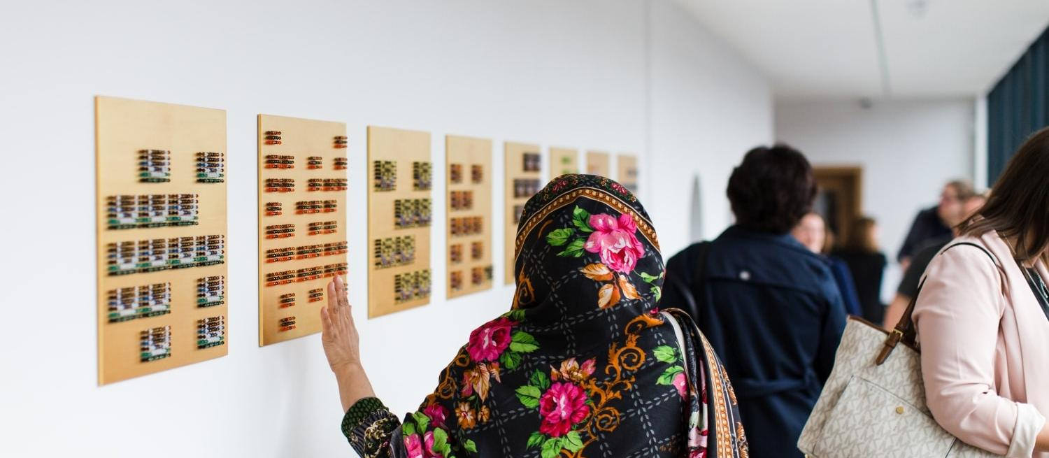 Visitor exploring an exhibition