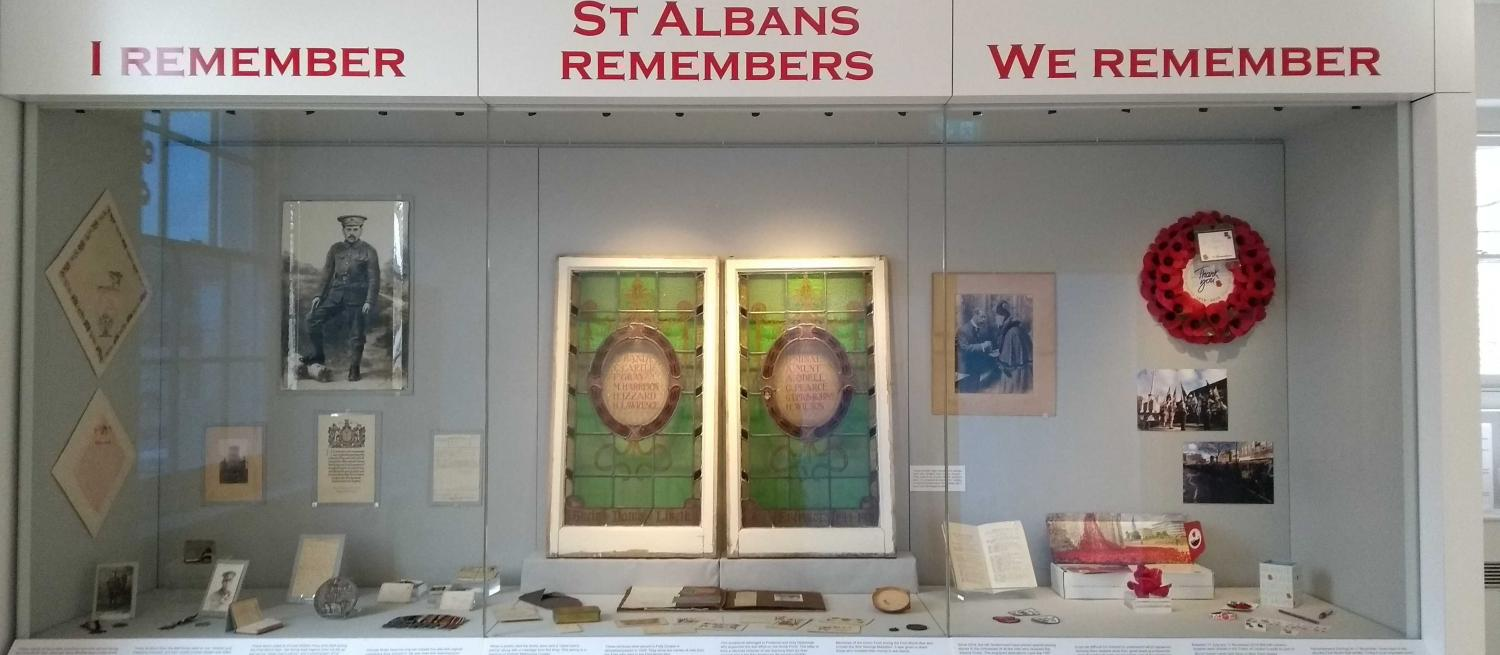 Museum display csaes with I Remember, St Albans Remembers, We Remember written above them