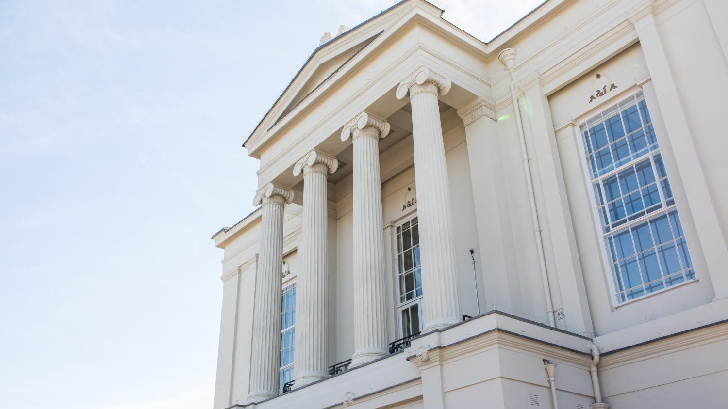 St Albans Museum + Gallery balcony from the side with a blue sky