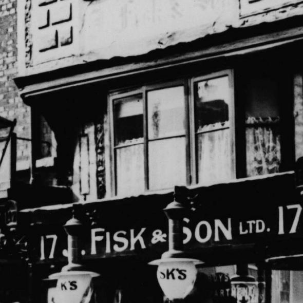 Monochrome photographic print showing Fisk & Son's shop at 17 High Street, St Albans