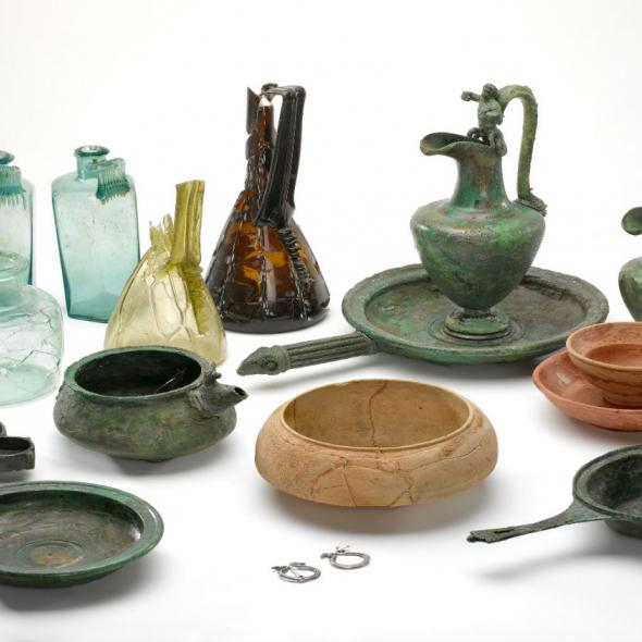 collection of roman objects including glass, pottery and metal containers