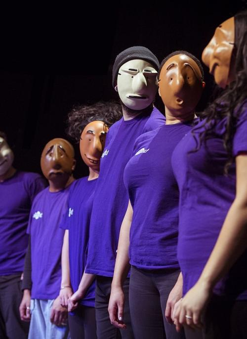 Members of Trestle Theatre Company wearing the Trestle masks